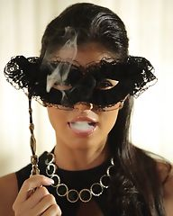 Smoking slut with a mask shows her big boobs