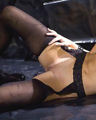 Brunette in black lingerie shows great body
